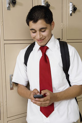 High School Boy Text Messaging by School Lockers