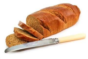 Whole wheat bread and table knife isolated