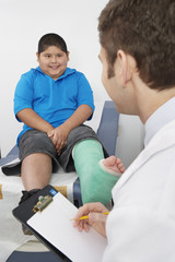 Doctor interviewing boy-patient