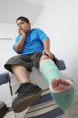 Boy with leg in plaster cast