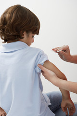 Boy being prepared to receive injection