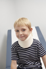 Boy wearing neck brace in hospital,portrait