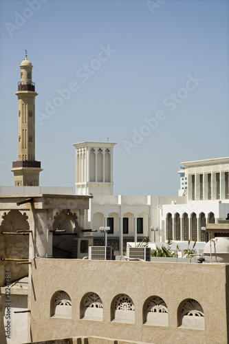 uae, dubai, old windtowers and minaret of the grand mosque in bur dubai