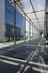 uae, dubai, architectural detail of a long outdoor hallway at the dubai international financial centre