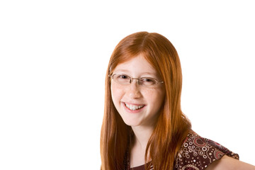 Friendly redhead Pre-Adolescent girl in glasses