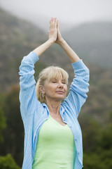 Middle-aged woman practicing yoga