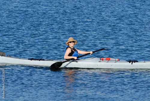 Attractive young woman in a kayak