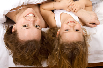 Girls having some fun in bed