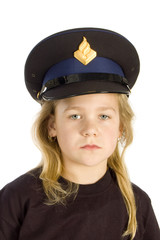 Little girl is wearing a police hat