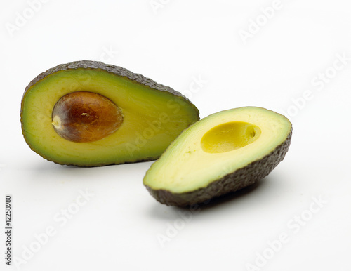 Avocado sliced in two isolated on white background