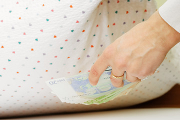 Hiding money under pillow