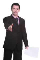 young businessman offering a hand