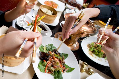 Holiday dinner in asian restaurant - 12267532
