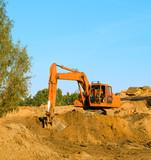 excavator on gravel poster