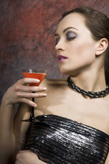 young sexy woman with glass of wine
