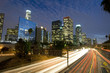 Los Angeles skyline and freeway at dusk