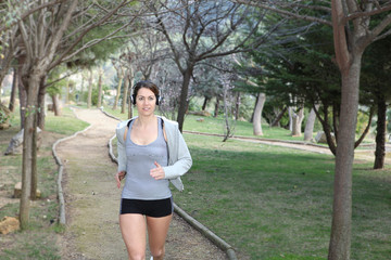 fit healthy woman running or jogging