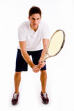 front view of player holding racket