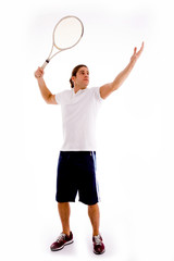 front view of tennis player servicing