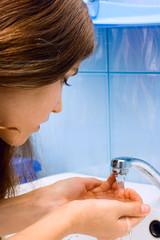 Teen girl wash hands