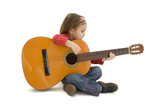 little girl playing acoustic guitar isolated on white