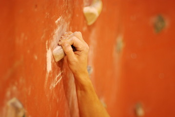 Strong hand on the  climbing wall