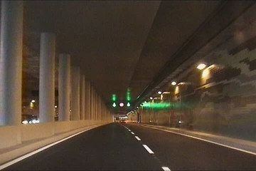 Driving through a tunnel in city