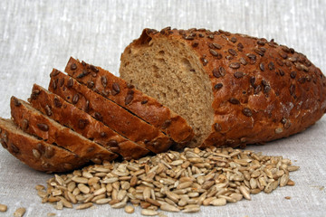 Sliced loaf of bread with sunflower seeds