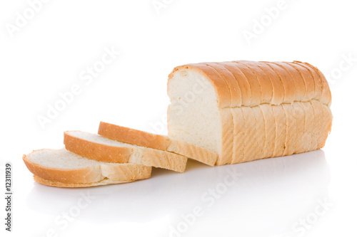 Foto Spatwand Brood Sliced loaf of bread isolated on white background