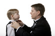Man Fixing Bow Tie on a Boy's Suit