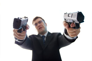Unfocused criminal businessman with aimed guns over white
