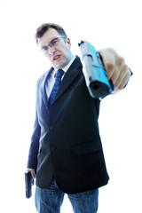 Angry criminal businessman with aimed gun on white