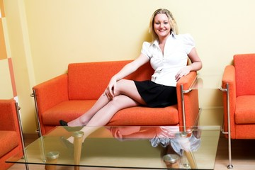 Woman in white sit on armchair