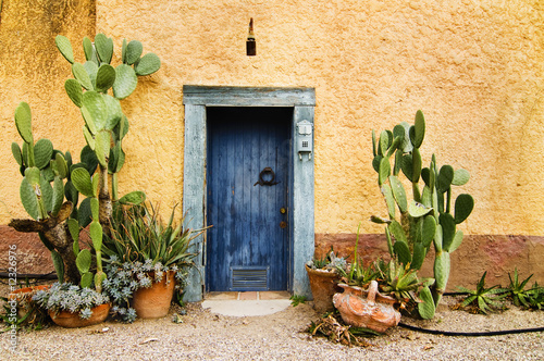 Leinwandbild Motiv Charming rustin weather worn doorway in hot climate country