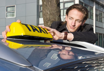 Placing the Taxi sign