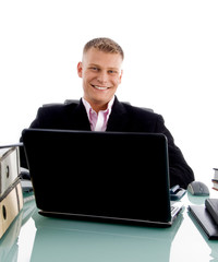 smiling young businessman at desk working