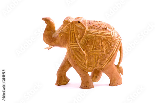 Wooden elephant sculpture isolated on white