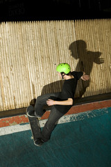 Skateboarder going up ramp to do a trick