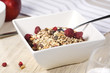 muesli with dried fruit in square bowl