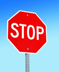 Stop Sign, Isolated against a blue gradient sky