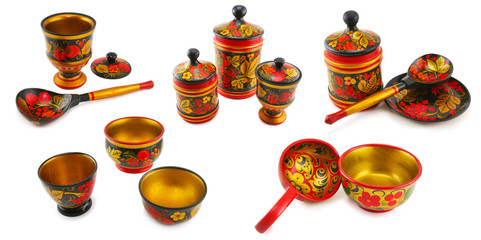 Set of painted wood tableware isolated