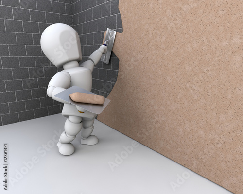 person plastering a  wall