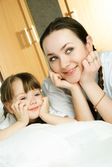 mother and daughter on the bed