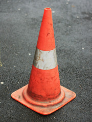 orange traffic cone placed in city street