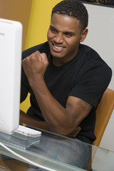 Young Man Using Desktop Computer