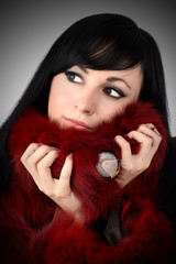 brunette is in a red fur coat
