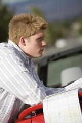 Man Looking at Road Map