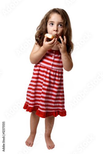 Little girl eating doughnut - 12375135