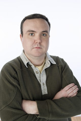 Overweight mid-adult man standing with arms crossed, portrait