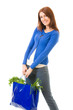 Young happy woman with shopping bag, isolated on white